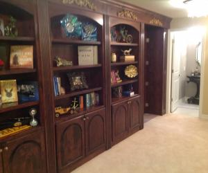 Castle Pines bookshelf and bathroom with open hidden room