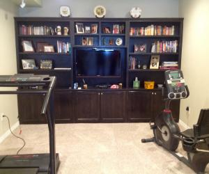 Workout equipment near tv bookcase