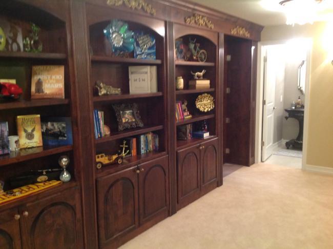 Castle Pines Bookshelf And Bathroom With Open Hidden Room