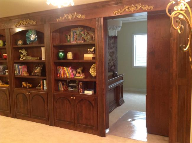 Castle Pines bookshelf hidden room Custom Integrated Designs Ltd