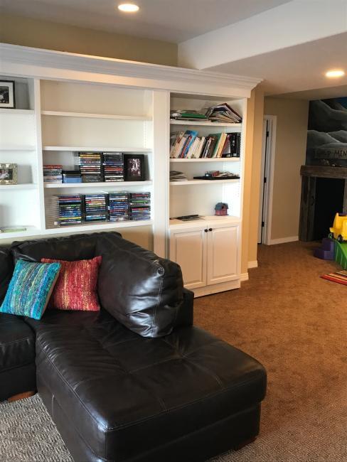 Media room shelf showing kids play area custom for Kids media room